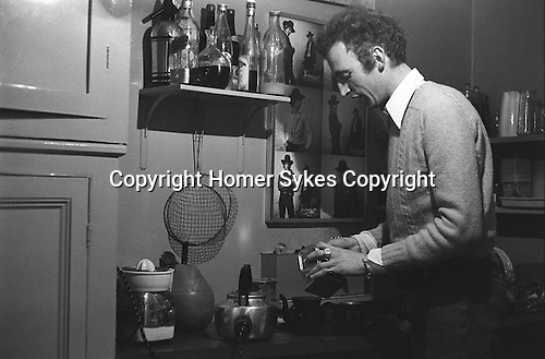 Patrick Procktor Manchester Street flat London 1969. PP making a pot of tea. The photographs on the wall are of Gervase Griffiths, taken by Cecil Beaton.