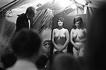 Pinner annual  Fair granted by Edward 111 in 1336. Middlesex. England 1971. Strip tease tent. It's the end of the show the girls are about to leave the tiny stage; the curtain is drawn back Humphrey Bogart eye looks on.<br /> <br /> 16x12 PARIS 2015 LES DOUCHES LA GALERIE <br /> <br /> <br /> THIS ARE MEDIUM RES FILES ONLY FOR REFERENCE AND SHOULD NOT BE SENT OUT THEY OPEN AT 11MGB