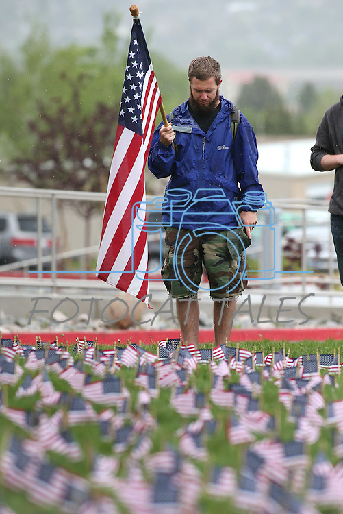 Army veteran Clinton Sisk listens to taps during a ceremony at the second annual Suicide Awareness March at Western Nevada College, in Carson City, Nev. on Saturday, May 7, 2016. The event raises awareness about the average 22 veteran suicides each day in the U.S. and the local services available to help. <br />Photo by Cathleen Allison/Nevada Photo Source