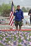 Army veteran Clinton Sisk listens to taps during a ceremony at the second annual Suicide Awareness March at Western Nevada College, in Carson City, Nev. on Saturday, May 7, 2016. The event raises awareness about the average 22 veteran suicides each day in the U.S. and the local services available to help. <br />