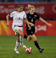USWNT midfielder (11) Carli Lloyd fights for the ball with  New Zealand midfielder (4) Katie Hoyle while playing at Wulihe Stadium. The USWNT defeated New Zealand, 4-0, during the 2008 Beijing Olympics in Shenyang, China.  With the win, the USWNT won group G and advanced to the semifinals.