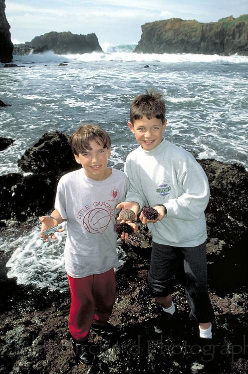 Children exploring tide pools near Mendocino, California Model released.CD scan from 35mm slide film  © John Birchard