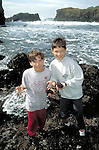 Children exploring tide pools near Mendocino, California Model released.CD scan from 35mm slide film  © John Birchard