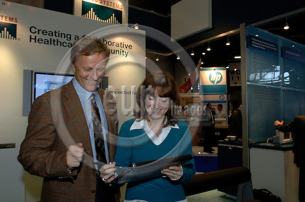 GENEVA - SWITZERLAND 12. 10. 2006 -- The World of Health IT. Exhibition: Jean Noel Enckle and Sarah Green from Cisco -- PHOTO: GORM K. GAARE / EUP- IMAGES ...