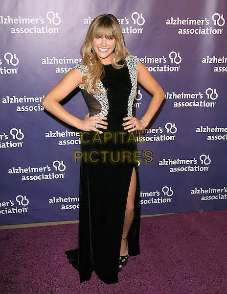 """GINA PHILIPS .at The 19th Annual """"A Night at Sardi's"""" benefitting the Alzheimer's Association held at The Beverly Hilton Hotel in Beverly Hills, California, USA,.March 16th 2011..full length black dress hands on hips long maxi slit split silver embellished mirror mirrored shiny bracelet .CAP/RKE/DVS.©DVS/RockinExposures/Capital Pictures."""