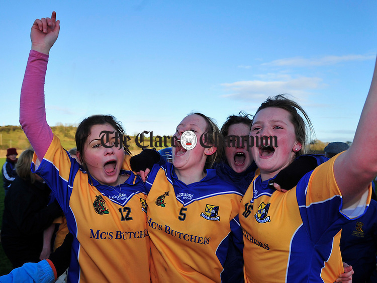 Shauna Chaplin, Ciara Whelan and Niamh Corry celebrate at the final whistle. Photograph by Declan Monaghan