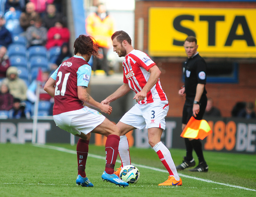 Stoke City's Erik Pieters looks to get past Burnley's George Boyd<br /> <br /> Photographer Andrew Vaughan/CameraSport<br /> <br /> Football - Barclays Premiership - Burnley v Stoke City - Saturday 16th May 2015 - Turf Moor - Burnley<br /> <br /> &copy; CameraSport - 43 Linden Ave. Countesthorpe. Leicester. England. LE8 5PG - Tel: +44 (0) 116 277 4147 - admin@camerasport.com - www.camerasport.com
