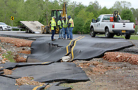 NWA Democrat-Gazette/DAVID GOTTSCHALK   Washington County Road Department personnel survey the damage Monday, May 1, 2017, on WC Road 859 in Wheeler. Heavy rains caused flooding from local area creeks including Clear Creek.
