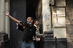 "Remi OCHLIK/IP3 -  Tahrir Square in Cairo November 23, 2011 -   Protesters clash with the anti riot police in the sweet going to the ministry of interior Egypt's ruling military moved up the date for transferring power to a civilian government to July next year and consulted Tuesday with political parties on forming a new Cabinet. But the major concessions were immediately rejected by tens of thousands of protesters in Cairo's iconic Tahrir Square threatening a ""second revolution.  Egyptian troops moved into streets around the Interior Ministry in Cairo on Wednesday, replacing riot police who had repeatedly clashed with protesters trying to reach the building, an army officer said. Riot police withdrew inside the ministry. The removal of the widely hated police seemed to be part of efforts to calm violence that has killed more than 30 people and wounded 2,000 in Cairo and elsewhere in six days of protests targeting the ruling military council, not the army itself. The Interior Ministry, near Tahrir Square, has been the main flashpoint for clashes in which police have fired tear gas, pellets and rubber bullets at stone-throwing demonstrators."