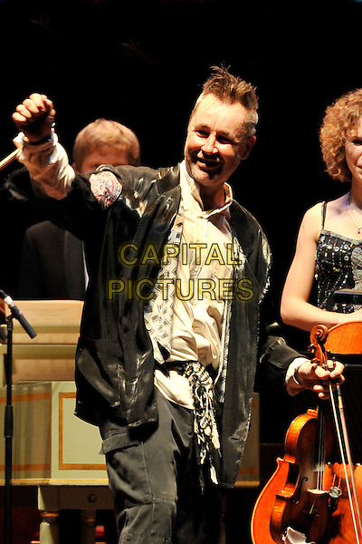 NIGEL KENNEDY.Performing live at the Royal Albert Hall, London, England..November 3rd, 2010.stage concert live gig performance music half length black jacket white hand arm.CAP/MAR.© Martin Harris/Capital Pictures.