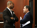 Nevada Senate Minority Leader Aaron Ford, D-Las Vegas, left, and Majority Leader Michael Roberson, R-Henderson, talk on the Senate floor during a special session at the Nevada Legislature in Carson City, Nev. on Tuesday, Oct. 11, 2016. <br /> Photo by Cathleen Allison