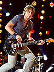 Keith Urban performs at LP Field during Day 3 of the 2013 CMA Music Festival in Nashville, Tennessee.