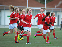 The Sacred Heart team celebrate Olivia Wallis' (left) late winner during the Wellington girls college football bronze playoff final between Sacred Heart College and Wellington High School at Wakefield Artificial Turf,  Wellington, New Zealand on Wednesday, 21 August 2013. Photo: Dave Lintott / lintottphoto.co.nz