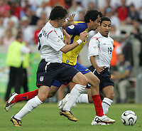 Ecuadorian forward (10) Ivan Kaviedes is closed down by English midfielders (16) Owen Hargreaves and (19) Aaron Lennon.  England defeated Ecuador, 1-0, in their FIFA World Cup round of 16 match at Gottlieb-Daimler-Stadion in Stuttgart, Germany, June 25, 2006.