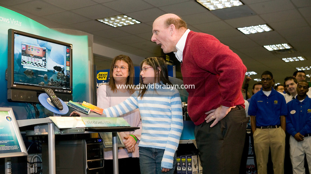 30 January 2007 - New York City, NY - Steve Ballmer, CEO of Microsoft watches Cassidy Mason (2L) demonstrate the new Windows Vista software during a promotional event in a Best Buy store in New York City, 30 January 2007, the day of the official launch for consumers of the Windows Vista operating system and Office 2007 software suite.
