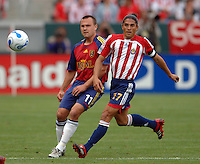 Real Salt Lake's Chris Brown  and CD Chivas Juan Francisco Palencia watch the ball get away from them in the second half at the Home Depot Center in Carson, CA on Saturday night, April 2, 2006..(Matt A. Brown/ISI)