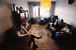 From coverage of revisit to Material World Project family in Ulaanbaatar, Mongolia in 2001. Oyuntsetseg Lhkamsuren, left, and her two children and niece, sit in the room they have rented from an 83-year-old Russian immigrant, to live in.