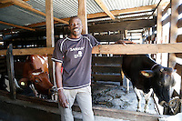 Sanderson is a farmer from Kenya who's now managing a large farm outside Arusha in Tanzania. The farm he runs has 300 cattle producing milk, as well as a coffee plantation and other crops.<br /> <br /> His farm had a biogas system installed last year, so now all the manure waste from the cows goes into producing bio-gas, which provides all the fuel they need for cooking meals for all of the farm workers. The slurry by-product of the biogas is used for fertilising their crops as well, which has led to better quality soil and increased harvests.<br /> <br /> Picture: Russell Watkins/Department for International Development