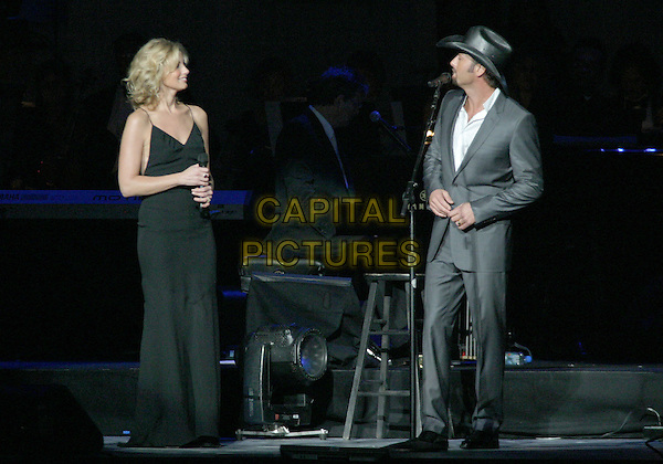 FAITH HILL & TIM McGRAW.The 9th Annual Agassi Grand Slam for Children..Photo: Kevin Ferguson/2004.October 2nd, 2004.full length, concert, stage, live, gig, singing, gray, grey suit, hat.www.capitalpictures.com.sales@capitalpictures.com.©Kevin Ferguson/AdMedia/Capital Pictures