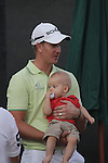 Henrik Stenson with his young baby speaking to the media after his second round of the Dubai World Championship on the Earth Course at the Jumeirah Golf Estate, Dubai..Picture Fran Caffrey/www.golffile.ie.