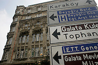 Road sign with historical building in background in Beyoglu, Istanbul, Turkey