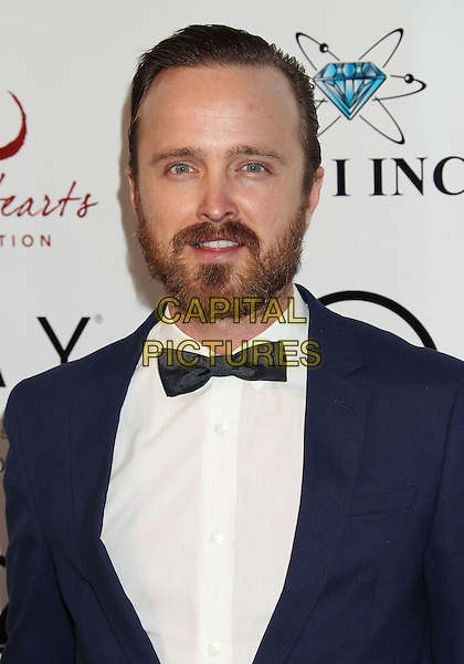10 May 2014 - Malibu, California - Aaron Paul. Open Hearts Foundation 4th Annual Gala.  <br /> CAP/ADM/RE<br /> &copy;Russ Elliot/AdMedia/Capital Pictures