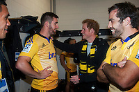 Hurricanes captain Conrad Smith (right) introduces Prince Harry to Mark Abbott in the Hurricanes changing rooms after the Super Rugby match between the Hurricanes and Sharks at Westpac Stadium, Wellington, New Zealand on Saturday, 9 May 2015. Photo: Dave Lintott / lintottphoto.co.nz
