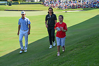 Billy Horschel (USA) and Tommy Fleetwood (ENG) depart the green on 18 with a happy St. Jude patient following round 4 of the WGC FedEx St. Jude Invitational, TPC Southwind, Memphis, Tennessee, USA. 7/28/2019.<br /> Picture Ken Murray / Golffile.ie<br /> <br /> All photo usage must carry mandatory copyright credit (© Golffile | Ken Murray)