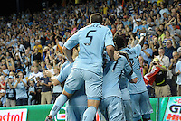 Sporting KC players celebrate Jacob Peterson's opening goal..Sporting Kansas City defeated Philadelphia Union 2-1 at LIVESTRONG Sporting Park, Kansas City, KS.
