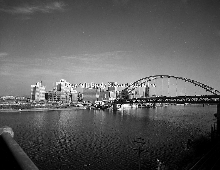 Pittsburgh PA:  View of Gateway Center and Fort Pitt Bridge construction from the Point Bridge - 1959