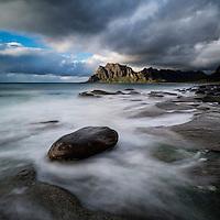 Waves break across rocky coastline at Unstad beach, Vestvagoy, Lofoten Islands, Norway