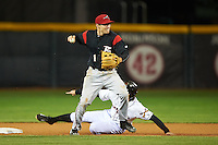 Richmond Flying Squirrels second baseman Kelby Tomlinson (1) throws to first as Josh Prince slides in during a game against the Erie Seawolves on May 19, 2015 at Jerry Uht Park in Erie, Pennsylvania.  Richmond defeated Erie 8-5.  (Mike Janes/Four Seam Images)