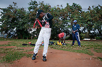 Felix Barugahare, 11, prepares for baseball practice at sports field of St. Peter's School in Nsambya, neighbourhood of Kampala, Uganda on July 28 2011. Felix Barugahare plays 2nd base and is the youngest player on Rev. John Foundation Little League baseball team.