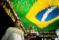 Rio de Janeiro nightlife, Academia da Cachaca Bar and Restaurant in Leblon quarter - Brazil flag on ceiling -  Cachaca is a distilled spirit made from sugarcane juice, also known as aguardente, pinga, caninha or other names, it is the most popular distilled alcoholic beverage in Brazil.