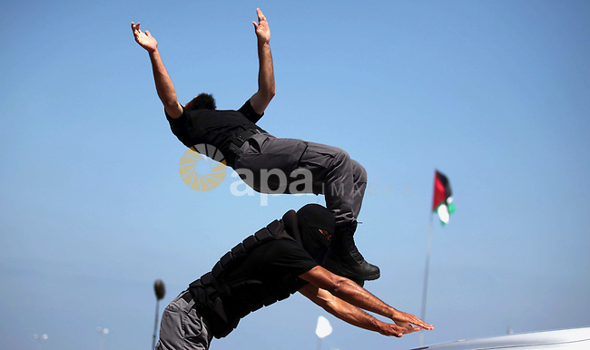 Members of the Palestinian Hamas security forces demonstrate their skills as they take part in a graduation ceremony in Gaza City on June 16, 2015. Photo by Ashraf Amra