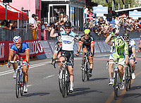 MARK CAVENDISH ALZA LE BRACCIA PER FESTEGGIARE LA VITTORIA DELLA PRIMA TAPPA DEL 96° GIRO D'ITALIA.Mark Cavendish of Great Britain and Omega Pharma Team win the first stage of 96° Giro d''italia cycling race