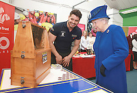 08 March 2016 - London, England - Queen Elizabeth II is shown the Queen Bee in a swarm of 30,000 by Peter Higgs of PGH Pest Control (a Prince's Trust Award Winner) at the Prince's Trust Centre in Kennington in London. Photo Credit: Alpha Press/AdMedia
