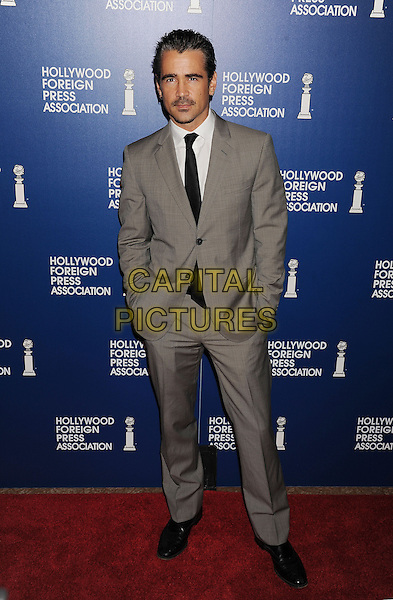 Colin Farrell<br /> Hollywood Foreign Press Association's 2013 Installation Luncheon held at The Beverly Hilton Hotel, Beverly Hills, California, USA.<br /> August 13th, 2013<br /> HFPA full length white shirt grey gray suit black tie hands in pockets <br /> CAP/ROT/TM<br /> &copy;Tony Michaels/Roth Stock/Capital Pictures