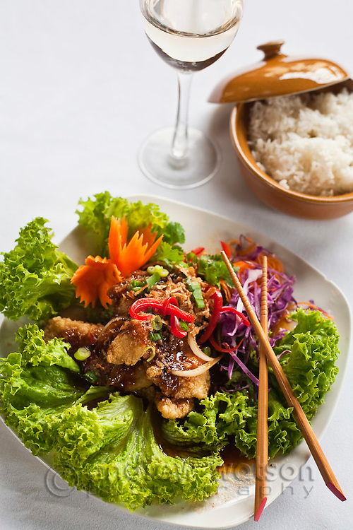 Thai-style sweet and sour fish with steamed rice.