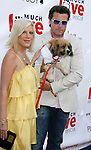 "Actress Tori Spelling and husband Dean McDermott arrive at the Much Love Animal Rescue Presents The Second Annual ""Bow Wow WOW!"" at The Playboy Mansion on July 19, 2008 in Beverly Hills, California."