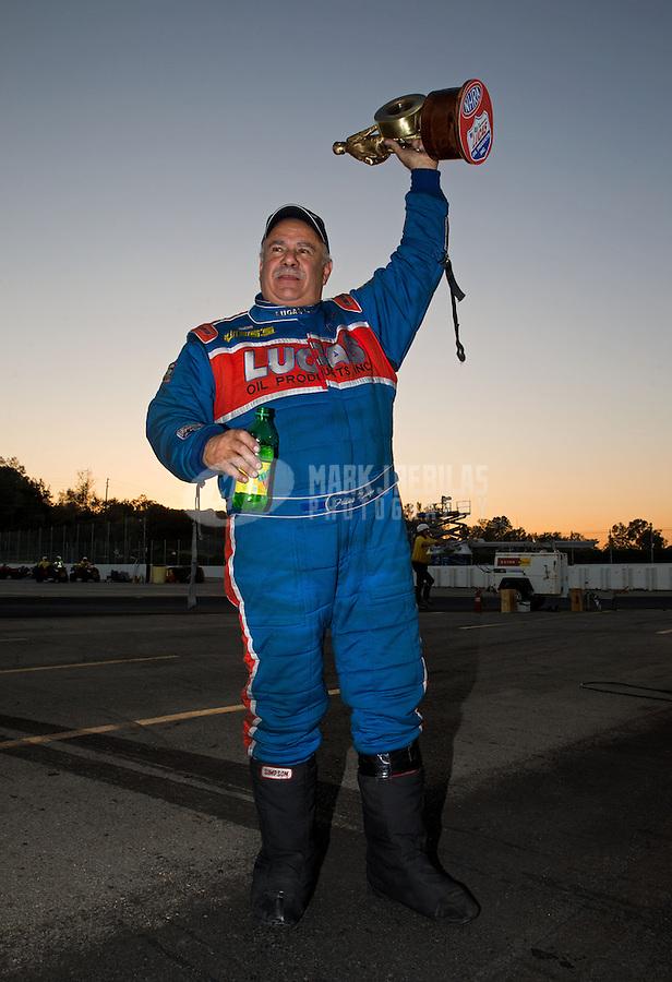 Nov 10, 2013; Pomona, CA, USA; NHRA top alcohol funny car driver Frank Manzo celebrates after winning the Auto Club Finals at Auto Club Raceway at Pomona. Mandatory Credit: Mark J. Rebilas-