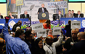 United States President Donald Trump makes remarks as protestors hold signs at the 2017 North America's Building Trades Unions National Legislative Conference at the Washington Hilton in Washington, DC, April 4, 2017.<br /> Credit: Olivier Douliery / Pool via CNP