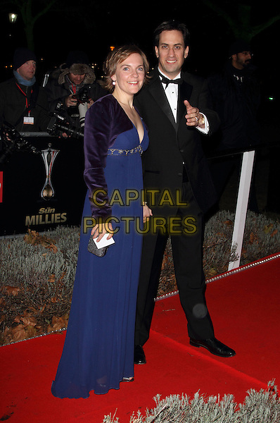 Justine & Ed Miliband.Arrivals at the 'Night of Heroes - The Sun Military Awards' at the Imperial War Museum, London, England, UK,.December 6th 2012..millies full length blue dress married couple husband wife long maxi purple shrug velvet finger gesture hand pointing black bow tie smiling Labour party leader .CAP/ROS.©Steve Ross/Capital Pictures.