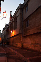 Brasenose Lane, at dusk just after the street lamps have come on, Oxford.