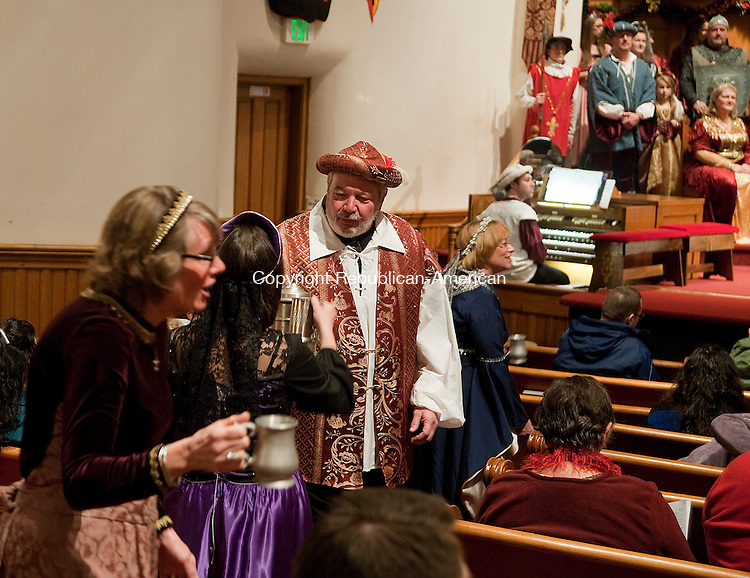 WINSTED, CT-010414JS02- Carolers sing Gloucestershire Wassail during the 24th Annual Boar's Head Festival Saturday at the First Church of Winsted. The even continues with a show today (Sunday) at 4 p.m. Tickets are still available at the door.  Jim Shannon Republican-American