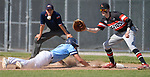 Belleville East's Gage Cruz (left) dives back to first base to avoid the pickoff throw to Alton first baseman Riley Phillips. Alton defeated Belleville East in a Class 4A regional semifinal at Alton High School in Alton, IL on Thursday May 23, 2019.<br /> Tim Vizer/Special to STLhighschoolsports.com