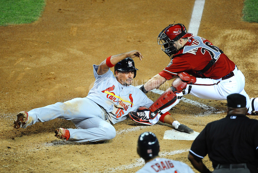 May 9, 2012; Phoenix, AZ, USA; St. Louis Cardinals base runner Rafael Furcal (left) is tagged out at the plate by Arizona Diamondbacks catcher Miguel Montero in the third inning at Chase Field. Mandatory Credit: Mark J. Rebilas-