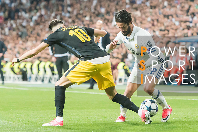 Isco Alarcon (r) of Real Madrid battles for the ball with Yannick Ferreira Carrasco of Atletico de Madrid during their 2016-17 UEFA Champions League Semifinals 1st leg match between Real Madrid and Atletico de Madrid at the Estadio Santiago Bernabeu on 02 May 2017 in Madrid, Spain. Photo by Diego Gonzalez Souto / Power Sport Images