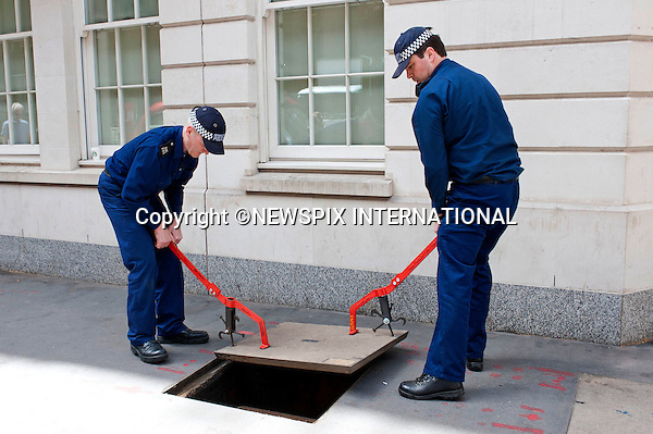 """PRESIDENT OBAMA STATE VISIT.Anti-terrorist police check under manhole covers for suspect devices, London_24/05/2011.Mandatory Photo Credit: ©Dias/Newspix International..**ALL FEES PAYABLE TO: """"NEWSPIX INTERNATIONAL""""**..PHOTO CREDIT MANDATORY!!: NEWSPIX INTERNATIONAL(Failure to credit will incur a surcharge of 100% of reproduction fees)..IMMEDIATE CONFIRMATION OF USAGE REQUIRED:.Newspix International, 31 Chinnery Hill, Bishop's Stortford, ENGLAND CM23 3PS.Tel:+441279 324672  ; Fax: +441279656877.Mobile:  0777568 1153.e-mail: info@newspixinternational.co.uk"""
