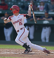 NWA Democrat-Gazette/ANDY SHUPE<br />Arkansas third baseman Casey Martin follows through with a swing against Kent State Friday, March 9, 2018, during the first inning at Baum Stadium in Fayetteville. Visit nwadg.com/photos to see more photographs from the game.